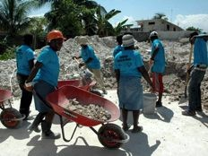 Haiti - Reconstruction : Women collect the rubble in a wheelbarrow for 10 months...