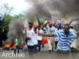 Haiti - Politic : The protesters crossing safety barriers of the National Palace