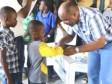 iciHaïti - Éducation : Le Ministre Nazaire distribue plus de 1,000 kits scolaires